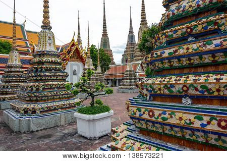 Bangkok, Thailand - June 30, 2016: Beautiful spired chedis housing the ashes of royal persons at Wat Pho in the Thai capital