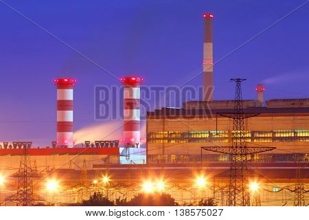 Electric substation in night-time lighting.Production, sale and distribution of electric energy in the industry.