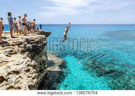 21 may 2016.Cape Greco. Man jumps into sea from a cliff at Cape Greco . Cyprus.