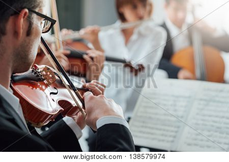 Violinist Performing With Classical Orchestra