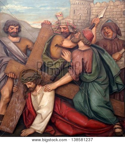 OBERSTAUFEN, GERMANY - OCTOBER 20: Jesus falls the second time, 7th Stations of the Cross, the parish church of St. Peter and Paul in Oberstaufen, Germany on October 20, 2014.