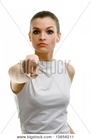 Young office woman in white shirt specifies with finger to isolated on white