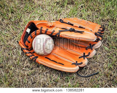 Nostalgic baseball in glove on a baseball field, Close up image