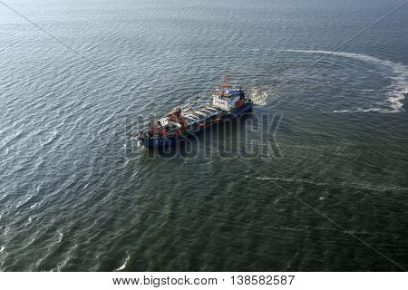 NAMIBIA - JAN 30. 2016: Chinese cargo ship Tong Li in the Atlantic Ocean off the coast of Africa near Luderitz port. Aerial view. Chinese expansion on the African continent increases from year to year
