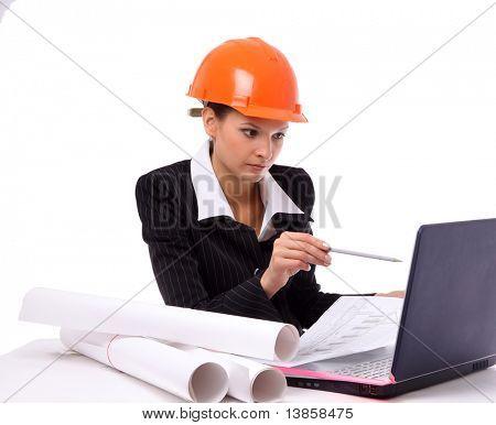 Smiling young female architect holding blueprints isolated on white background