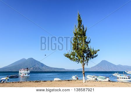 Boats & volcanoes: Atitlan Toliman & San Pedro at Lake Atitlan Guatemala, Central America