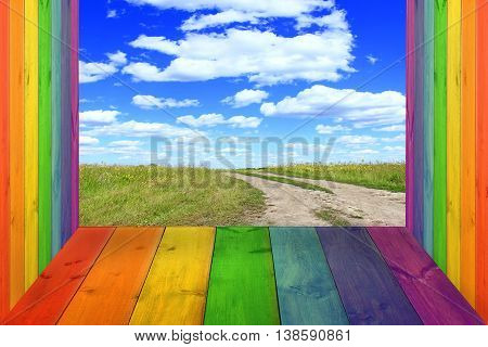 multicolored bright stand from wooden boards and blue sky with white clouds
