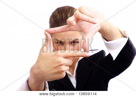 Beautiful young woman creating a frame with her fingers