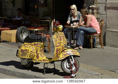 Milan Italy - April 19 2016: Milan wine shop special Vespa pick-up for delivery of the wine at home