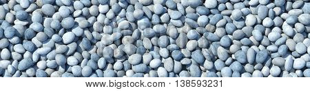 Many round pebbles from above as panorama background (3D Rendering)