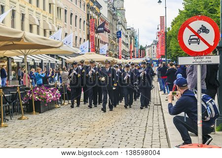 OSLO, NORWAY - JULY 1, 2016: A military band goes on Karl Johan Street in the changing of the guard near the Royal Palace.