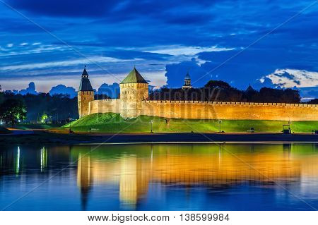 Wall and towers of Novgorod Veliky kremlin view from opposite side of river Volkhov Russia