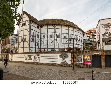 LONDON UK - 6TH JULY 2016: A view of the outside of Shakespeares Globe Theatre in the morning. A person can be seen.