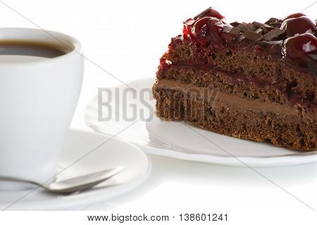 cup of coffee and piece of cake with cherries