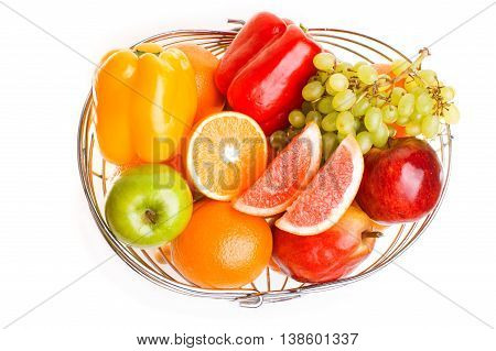 fruits in a basket isolated on white background