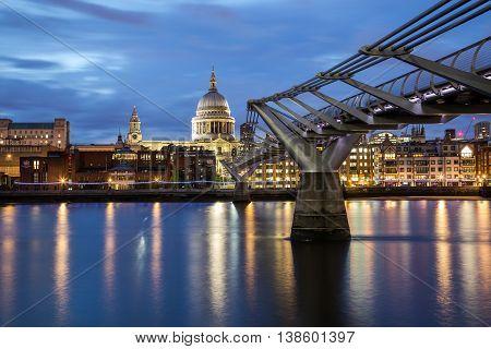 LONDON UK - 27TH JUNE 2016: St Pauls Cathedral and Millenium Bridge at night