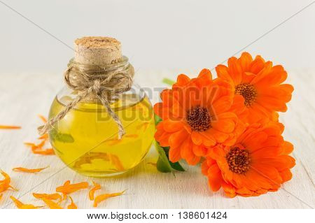 Marigold Oil With A Fresh Flower Bouquet