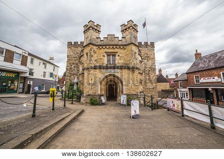 BUCKINGHAM UK - 4TH JULY 2016: A view of the Old Gaol in Buckingham Town center during the day. People can be seen.