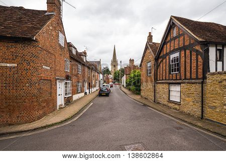 BUCKINGHAM UK - 4TH JULY 2016: A view along streets in the old part of Buckingham Town during the day. The outside of buildings can be seen.