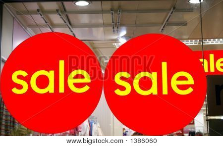 Sale Signs Hanged On The Window Of A Store