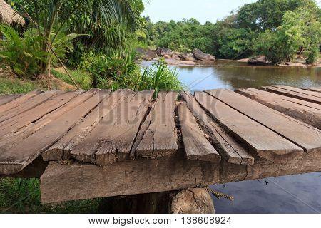 Wooden Pier Closeup - Riverside In Jungle Landscape