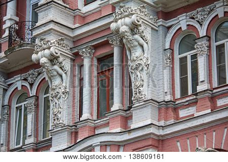 Facade of a historic building with statues. Kiev Ukraine