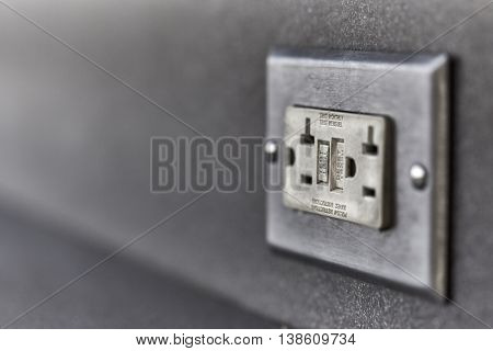 Used Ground fault circuit interrupter electrical wall outlet with shallow depth of field