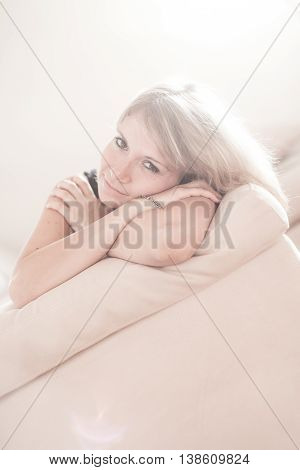Cute Young Girl Relaxing On Couch At Home. Hi Key Softfocus Image
