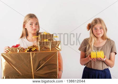 Siblings with different amount of gifts. One of them has much more than her sister