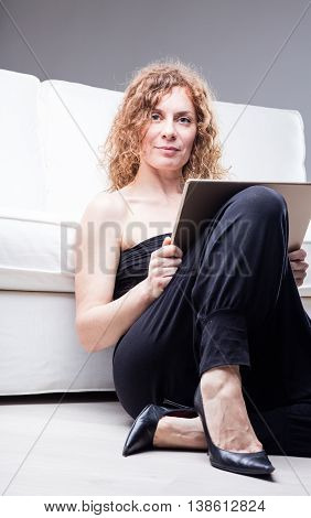 Middle Aged Woman With Frame Or Tablet In Hand