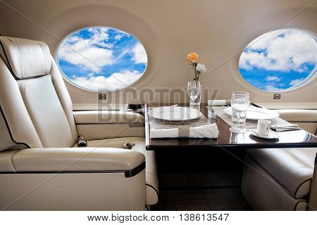 Clouds view in aircraft window, business jet flight