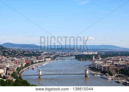 Aerial view of Budapest with Danube River in the center Hungarian Parliament Building on the right and the Chain Bridge and Margaret Bridge across Danube River