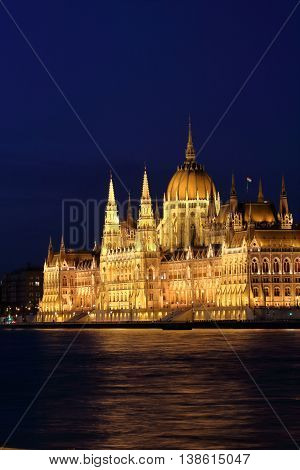 Night scene of Hungarian Parliament Building along Danube River in Budapest