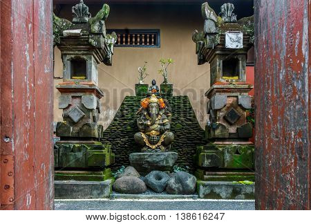 A statue of Ganesh in a courtyard in Bali