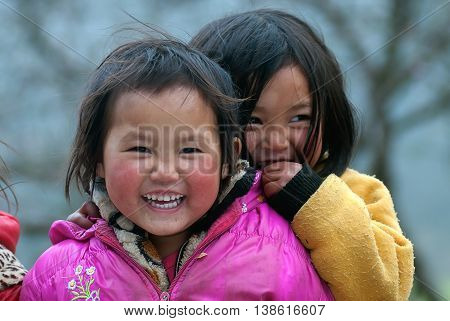 HA GIANG, VIETNAM, February 14, 2016 two, baby girl, ethnic Hmong, Ha Giang mountainous region, Vietnam, friendly smile