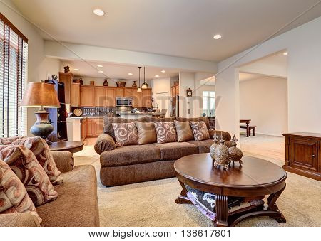 Classic Brown And White Living Room Interior With Carpet Floor.