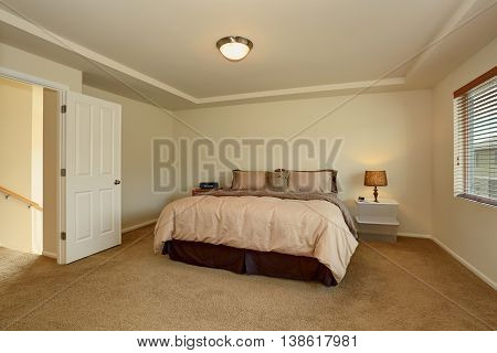 Simple Bedroom Interior With Double Bed And Carpet Floor.