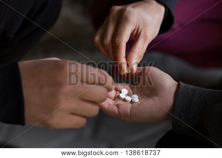 substance abuse, addiction and people concept - close up of addicts using drugs outdoors