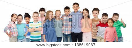 childhood, fashion, friendship and people concept - group of happy smiling children hugging