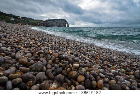 Pebbles beach in Normandy city Etretat, France