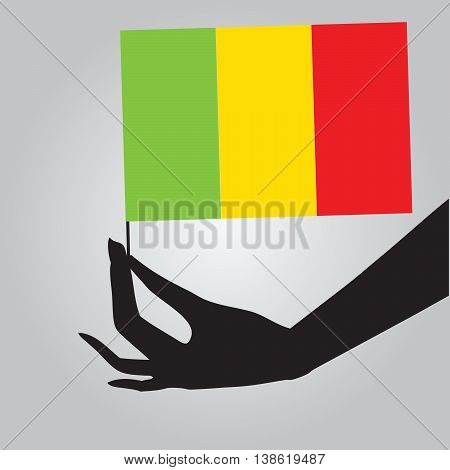 Flag of Mali in a female hand. Vector illustration.