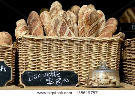 Baguettes in a bread basket at the market.