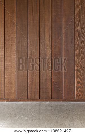 Cedar wooden boards on an interior wall on a concrete floor