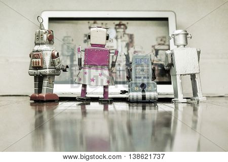 family of robots watch tv