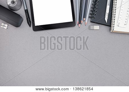 Workplace With Spiral Notebook, Various Drawing Tools, Tablet And Stylus