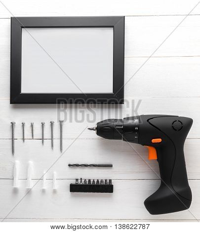 Blank Black frame with blank copy space. Driller with photo frame equipments.