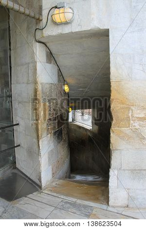 Entrance to spiral downstairs of the Leaning Tower in Pisa Italy