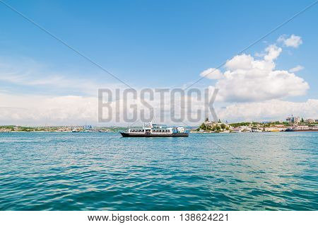 Passenger boat ferry on the sea water in the city center