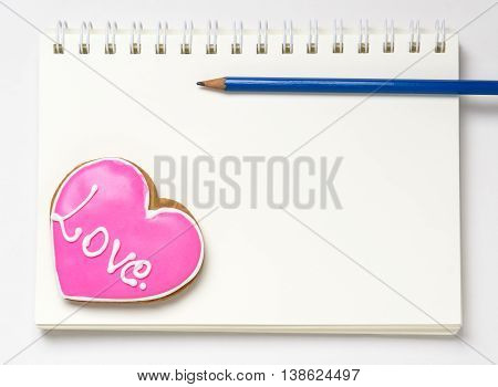 Love Diary Note book Blank page. Heart shaped Cookie on a blank diary page.