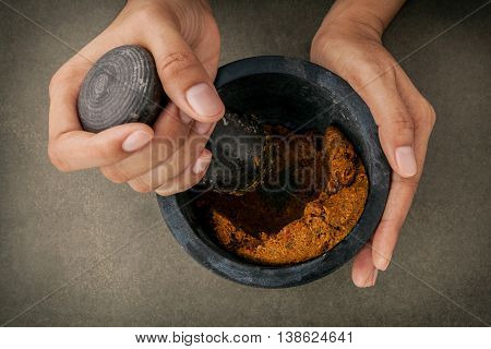 .the Women Hold Pestle With Mortar And And Spice Red Curry Paste Ingredient Of Thai Popular Food On